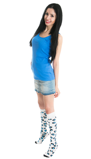 girl wearing jean skirt, blue top and blue cheetah knee socks