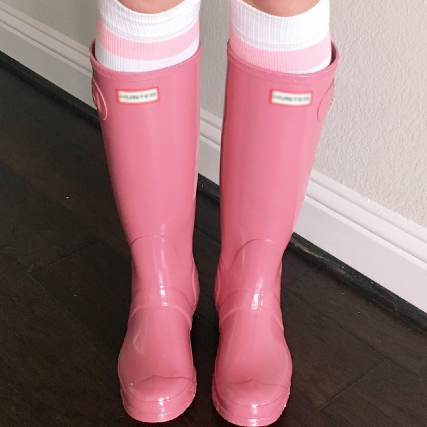 pink flat water boots with striped tube socks