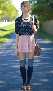 over the knee cat socks paired with blouse and skirt