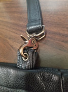 Strap with clasp.
