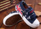 Navy Blue Canvas shoe with flag on top.