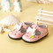 Baby Girl Pink Soft Soled Shoe with white bow to side.