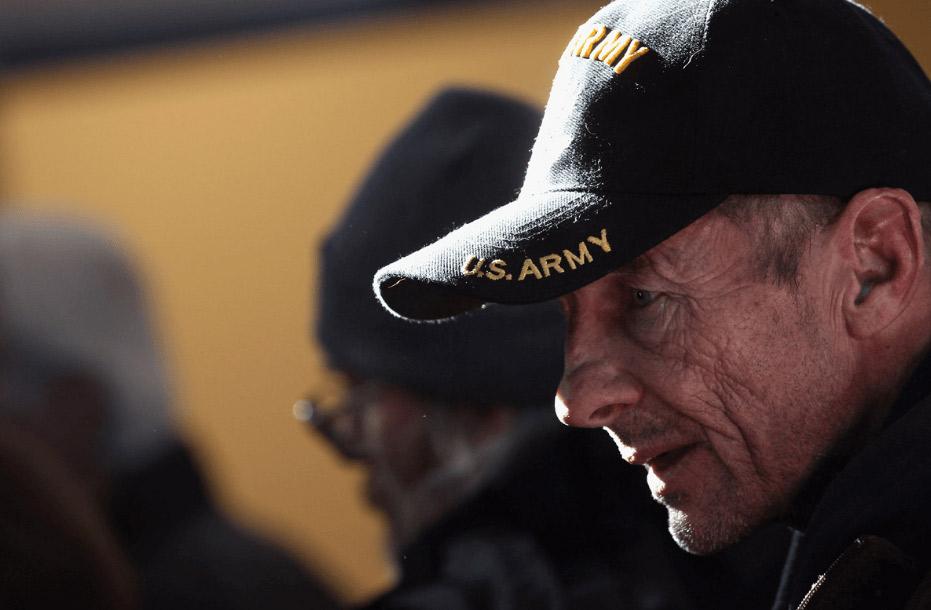 veteran holding a flag