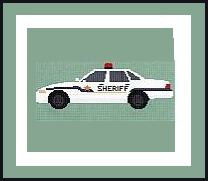 """Patrol Car Crochet Afghan Graph Pattern.  All done in single crochet, changing colors as you go along.  Drop one color, pull in the next.  Medium ability.  Size works up to be approx. 60 x 80"""".  Graph is 145 stitches wide by 185 stitches high.  Then you crochet 22 rows (or more) around the outside edge including a border.  Complete instructions are included, a full size graph, and a Helpful Hints page."""