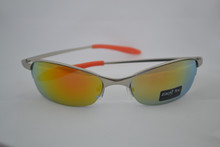 Sporty metal frame with yellow/orange lens and orange rubber tipped temples.