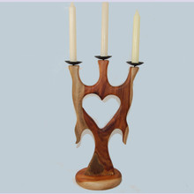 This lovely Wooden Heart Candelabra is sure to captivate a loved one. Made of Camphor Laurel, this scented wood also has a beautiful grain, adding to its attraction. Handmade in Australia.