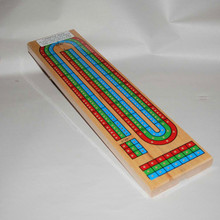 Cribbage Board with pegs for three players.