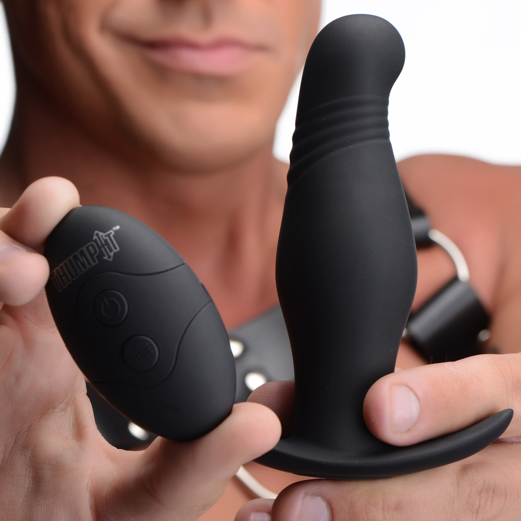 Thump It 7X Rippled Silicone Rechargeable Thumping Anal Plug - In Hand