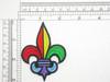 """Fleur De Lys Pride rainbow color Iron On Patch Applique - 3"""" high (75mm) x 2 3/16"""" wide (55mm)"""