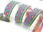 "Jacquard Ribbon 1 3/8"" Very Bright Aztec Pattern Priced per yard  If you order over 7 yards there will be a splice - join  Very Bright colors- one of the brightest Jacquards we have stocked - looks amazing in the sun!"