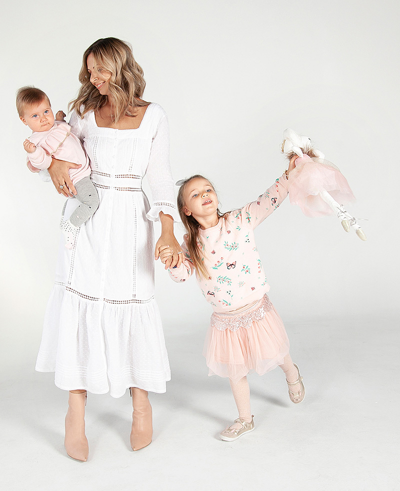 Women Holding Holding Hands With Young Girl