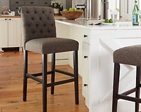 Ashley Tripton Tall Upholstered Bar Stool in Graphite