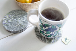 Rangeene Handmade Beaded Circle Silver Coaster with a Coffee Mug on Top
