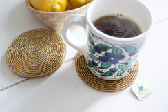Rangeene Handmade Beaded Circle Gold Coaster with a Coffee Mug on Top
