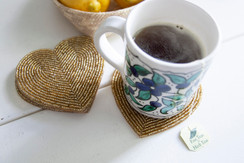 Rangeene Handmade Beaded Heart Gold Coaster with a Coffee Mug on Top