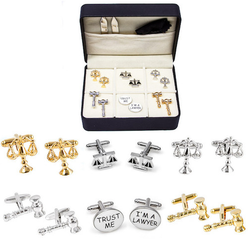 6 pairs of assorted criminal justice judicial theme cufflinks in presentation gift box. cufflinks assortment include: 1 pair gold scales of justice cufflinks 1 pair silver scales of justice cufflinks 1 pair gold gavel cufflinks 1 pair silver gavel cufflinks 1 pair black enamel and silver scales of balance cufflinks 1 pair Trust Me Im A Lawyer cufflinks 1 pair collar tabs 1 polishing cloth