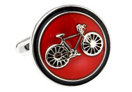 Round red button style cufflinks with silver bike in the center close up image