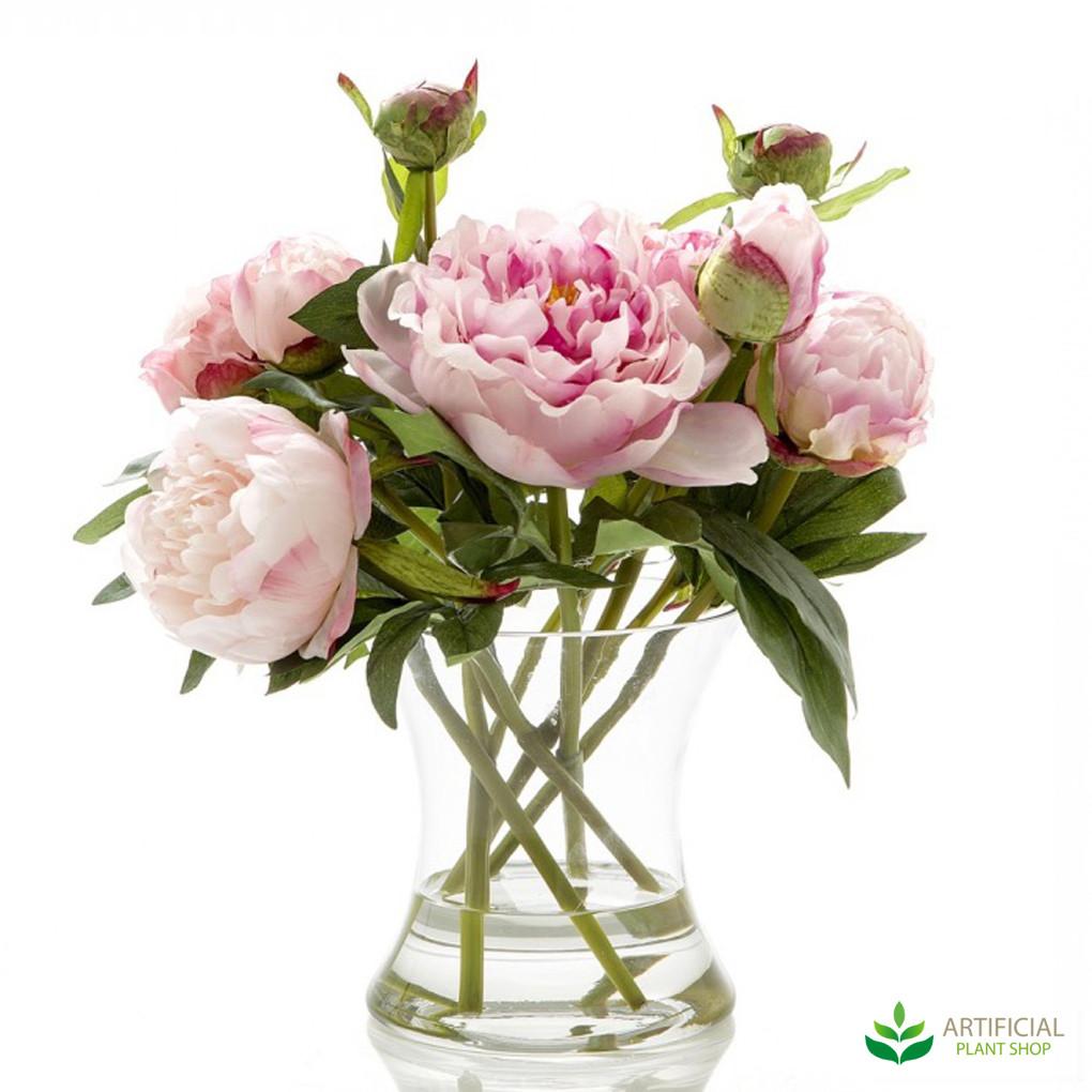 dark pink peonies in glass vase