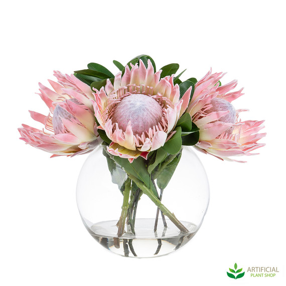 artificial proteas in glass vase