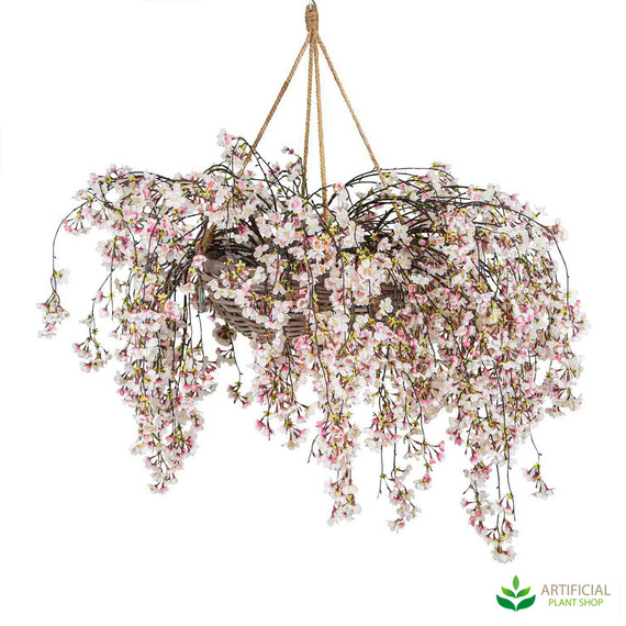 Artificial blossom flowers in hanging basket