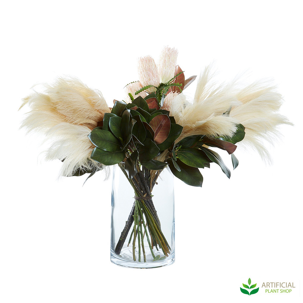 magnolia and pampas grass in glass vase
