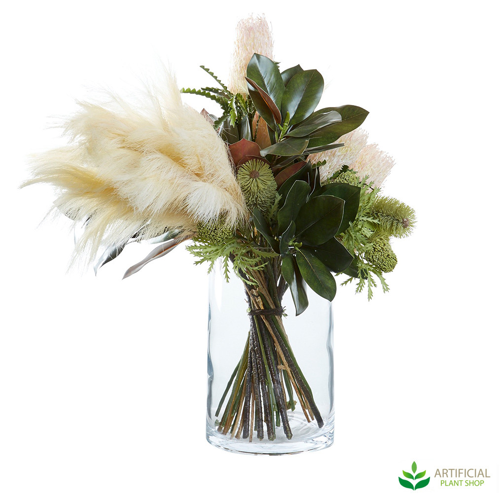 fake flower arrangement in glass vase
