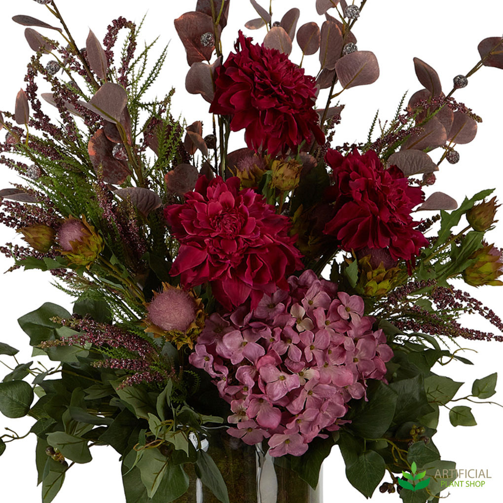 Mixed artificial flowers in red and pink