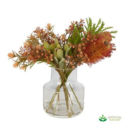 orange protea flower arrangement