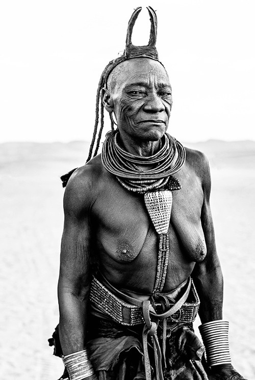 x1https://cdn10.bigcommerce.com/s-b76sgj/products/128/images/8576/Namibia_Himba_Elder_44x66_V11__39273.1631186495.1280.1280.jpgx2