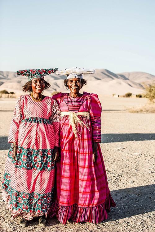 x1https://cdn10.bigcommerce.com/s-b76sgj/products/142/images/8342/Namibian_Herero_Women_44x66_V11__11966.1628653450.1280.1280.jpgx2