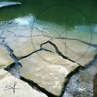 Belize River over Broken Concrete