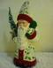Schaller Santa in cream coat with red trim