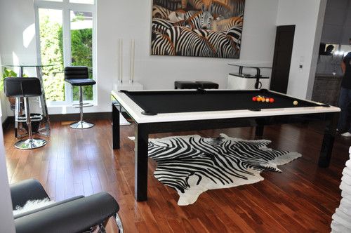 "The La Condo Evolution pool table is both sophisticated and sleek in design with it's white high gloss rails and black legs. This billiard table would be an exciting addition to any room.  Available in  6',7',8'and 9' lengths, this pool table is also available in 32"" pool table height or 30"" dining height."