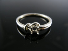 5762 LOVE KNOT RING STERLING SILVER , 4MM ROUND STONE SIZE 9