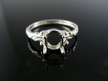 5590 RING SETTING STERLING SILVER , SIZE 7, 7X5 OVAL FACETED STONE