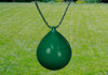 Green buoy ball on a green chain in front of a grass background.