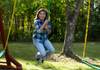 Outdoor view of girl on Green Disc Swing from Plan-It-Play.