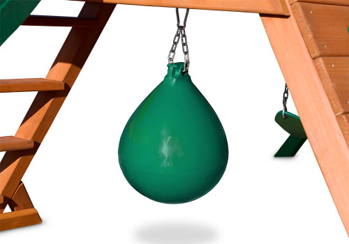 Green punching ball mounted underneath a swing set deck on a white background.