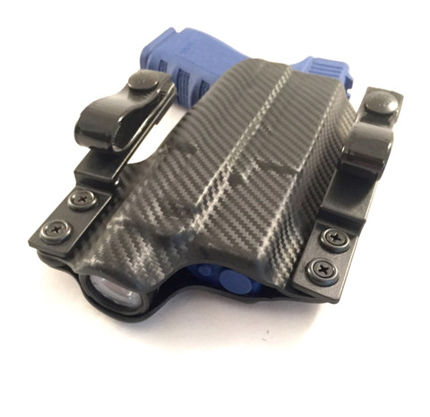 Our 2 piece Ultimate IWB for a Glock 19 w/ a TLR1-HL and twin tuckable soft loops with Pull-the-Dot snaps.