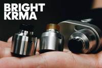 "Mission XV - ""KRMA Bright RDA"". Shown beside standard brushed cap and mounted to mod for demonstration purposes only. The brushed cap and mod are NOT included in this sale. This sale is only for the KRMA Bright RDA."