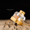 "Play Inc. - ""Play Gen 5 Mid Profile Beauty Ring and Drip Tip Set, Gold Colour"" shown attached to complete atomizer setup for demonstration purposes only. This sales listing is only for the drip tip and beauty ring combination."