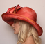 Cosmo Side View, Orange Derby Hat.