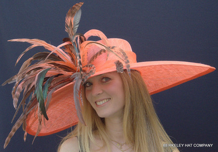 Papaya Orange Fabulous Feather Hat for the Derby.