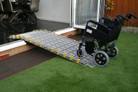 Roll-a-Ramp System Up and Over Thresholds