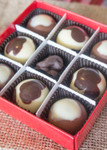 Brown Cow/Big Cheese Truffle 9 Piece box top-view with lid off