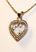 Rhinestones inside heart charm pendant necklace
