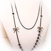 """ Tango Night in Buenos Aires "" Black Long Layered Chain Necklace with Golden Bows and Glass Strand"