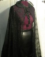 Beautiful Black on Black Spiderweb cape with Hood, note double closure in front.