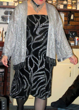 Silver metallic Lace Cover-ups are perfect for any occasion, and can be untrimmed on the bottom edge, trimmed with a regular black fringe, or a fancy fringe with fine metallic silver chain draped throughout the fringe.