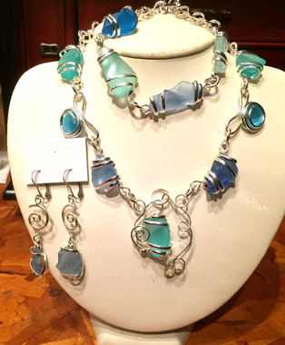 Beautiful Sea Glass Collection in Blue and Green , set in a neckband, buy the set For $62 or the individual pieces. Also comes in Pink/White.